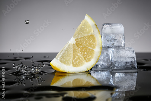 Lemon with water drop and ice cubes