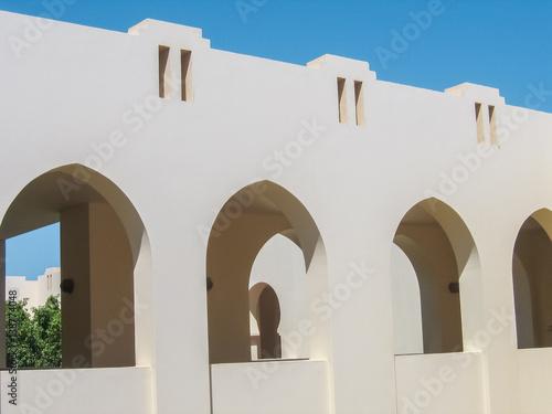 Fotografie, Obraz  Closeup of arabic architectural detail arches against sky
