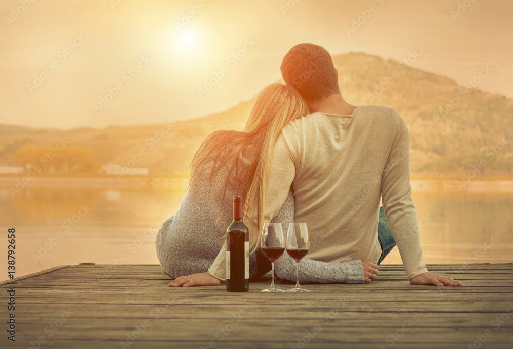 Fototapety, obrazy: Romantic Couple sitting on the pier with red wine.