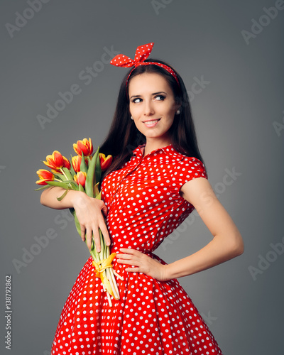 Cute Girl in Retro Red Polka Dress with Tulips Wallpaper Mural