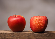 Two Red Apples On Table