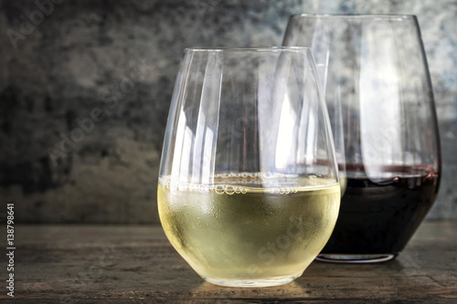 Fototapeta  White and Red Wine in Stemless Glasses with Slate Background
