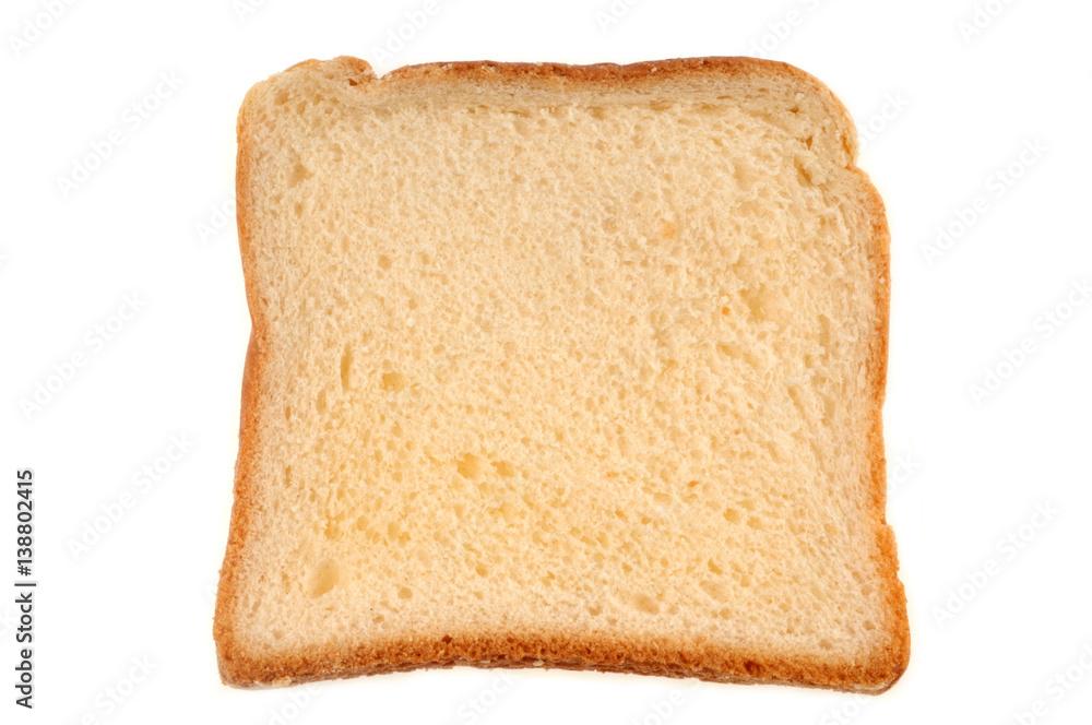 Tranche de pain de mie sur fond blanc