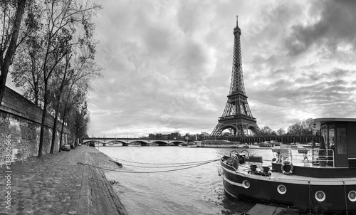Poster Paris Beautiful panoramic view of the Eiffel Tower and Jena bridge from the river Seine embankment. Dramatic cloudscape. BW photography. Paris, France.