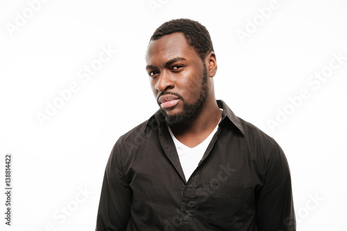 Attractive young african man dressed in shirt isolated Canvas Print