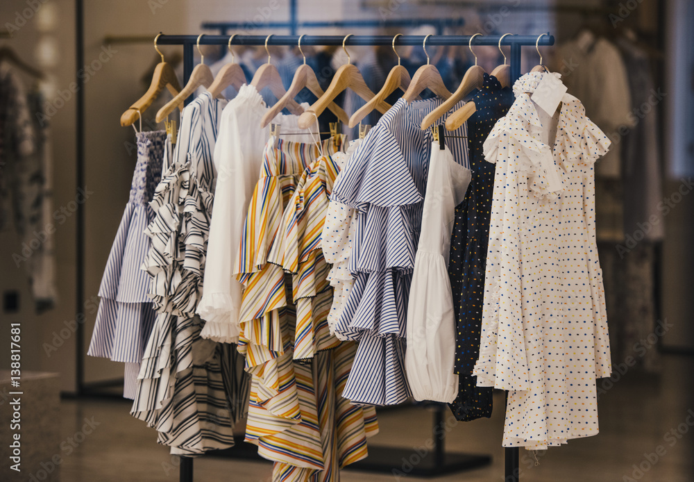 Fototapety, obrazy: Fashionable clothes in a boutique store in London.