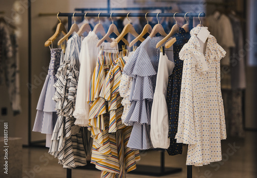 Obraz Fashionable clothes in a boutique store in London. - fototapety do salonu