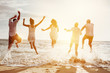 canvas print picture - Happy friends group people sunset sea