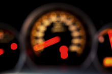Blurred Speed Gauge In Car. Abstract Background.