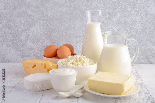 Fresh dairy products. Milk, cheese, brie, Camembert, butter, yogurt, cottage cheese and eggs on wooden table.