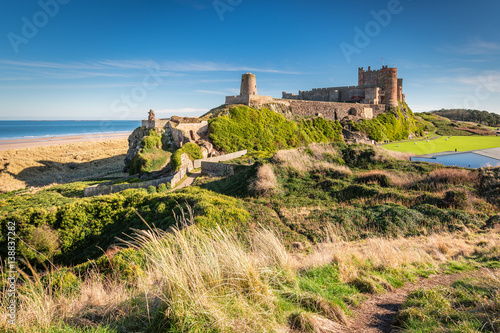 Wall Murals Northern Europe Elevated View of Bamburgh Castle / Bamburgh Castle viewed from an elevated hillock, on the Northumberland coastline