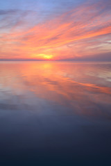 Coastal Sunset, Clouds Reflecting in the Calm Sea