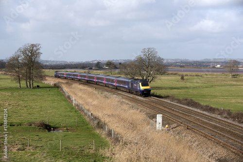 Pinturas sobre lienzo  A First Great Western company passenger train passing through English countrysid