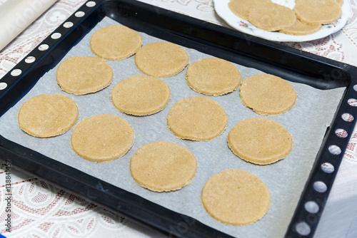 Valokuva  Raw oatmeal cookies on baking sheet