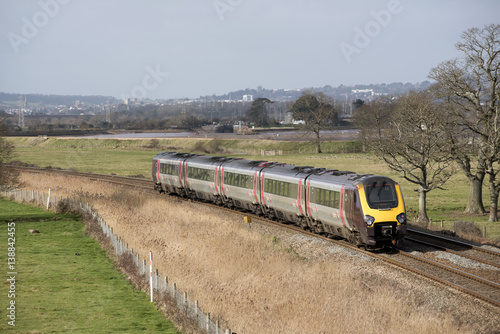 Fotografía  A Virgin Trains company passenger train passing through English countryside sout