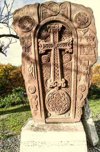 Foto op Canvas Monument Stone cross monument of reunification Armenian people's in autumn park among trees