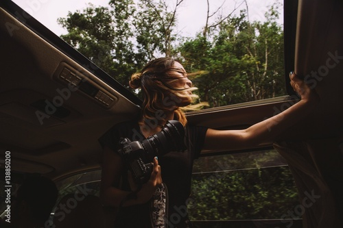 Low Angle View Of Woman Looking Through Sun Roof