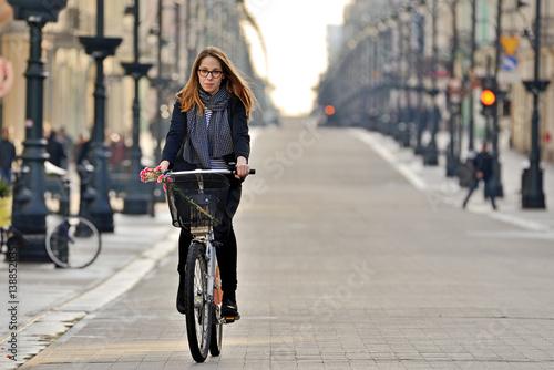 Fototapeta Young woman on a bicycle. obraz