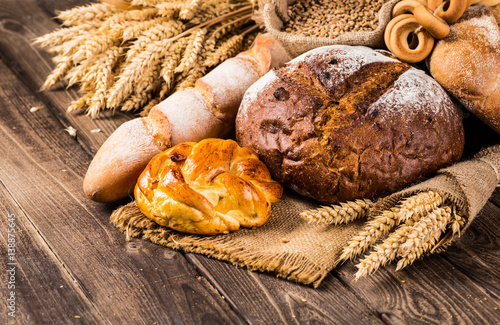 Fotografie, Obraz  Assortment of baked bread on wooden table background