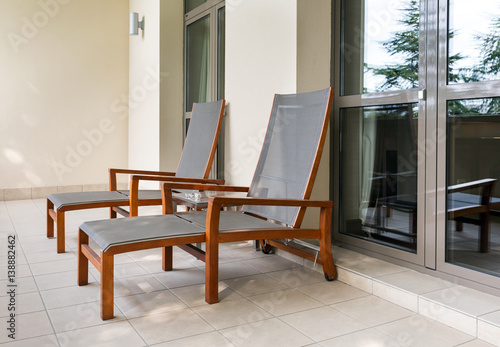 Photo Two chaise longue on balcony