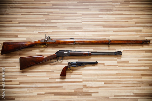 Classic American weapons on wooden background: Civil war rifle, Wild