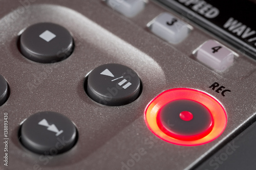 Photographie Red record button illuminated on recorder