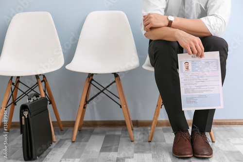 Photo Young man waiting for interview indoors