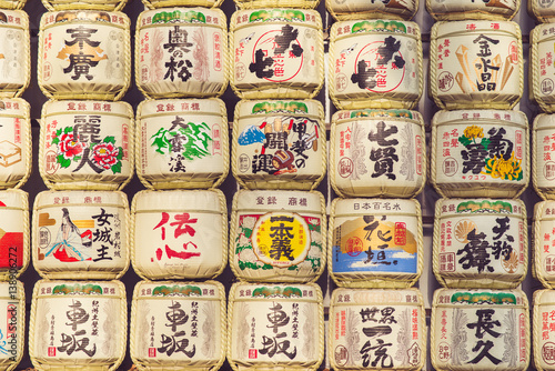 TOKYO, JAPAN - MARCH 30: A collection of Japanese sake barrels stacked is at the Japanese Meiji Shrine Wallpaper Mural