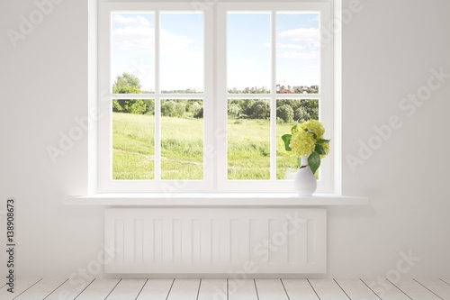 Fototapeta White empty room with green landscape in window. Scandinavian interior design obraz na płótnie