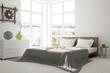 White bedroom with green landscape in window. Scandinavian interior design