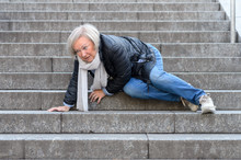 Senior Woman Falling Down Ston...