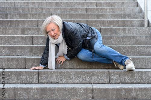 Fototapeta Senior woman falling down stone steps outdoors obraz