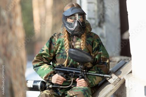 Foto op Aluminium Draken girl playing paintball in overalls with a gun.