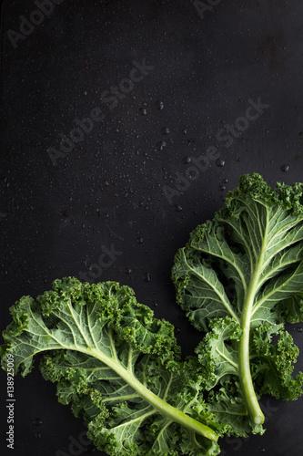 Fotografie, Obraz  fresh green organic kale leaves on dark background