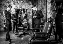Group Of Young Elegant Positive Mens Pose In Interior Of Barbershop. Black-white Photo.