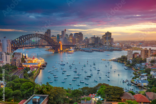 Spoed Foto op Canvas Australië Sydney. Cityscape image of Sydney, Australia with Harbour Bridge and Sydney skyline during sunset.