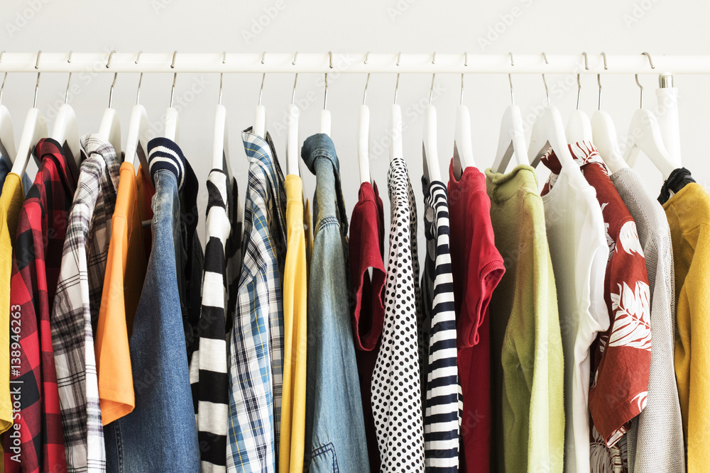 Fototapety, obrazy: Collection of clothes hanging on rack