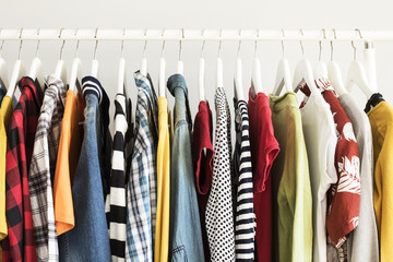 Collection of clothes hanging on rack