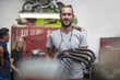 Portrait of smiling mechanic in motorcycle workshop