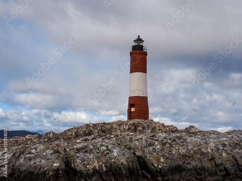 Garden Poster Lighthouse Old red lighthouse on rocky coastline