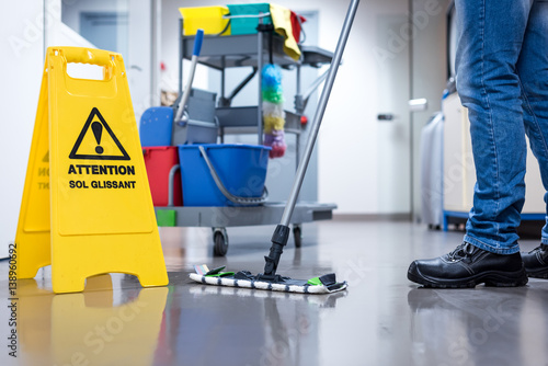 Fotografía  Worker janitor Mopping Floor In Office with trolley