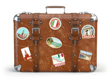 Old Suitcase Baggage With Travel Stickers Isolated On White Background.