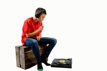 Teenage Boy Air Drumming While Listening To Music
