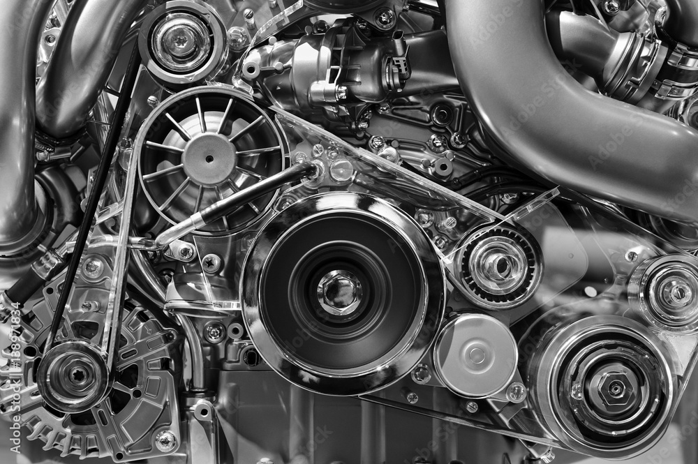 Fototapeta Car engine, concept of modern vehicle motor with metal, chrome, plastic parts, heavy industry, monochrome