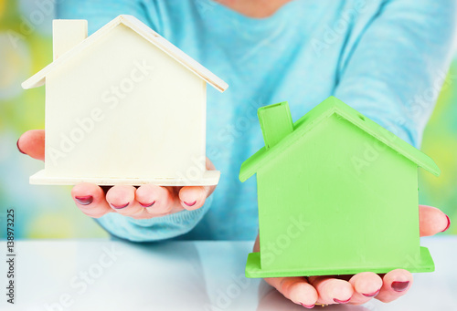 Photo  concept comparison between normal house and low consumption house