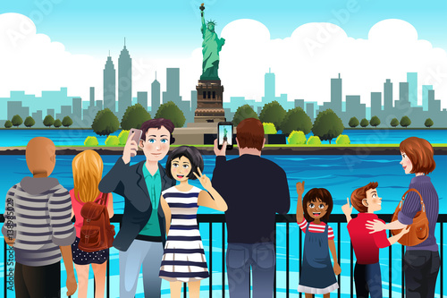 Fotografie, Obraz  Tourists Taking Picture Near Statue of Liberty