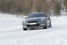 Sports Car Driving On Icy Road