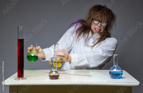 Fotografie, Tablou  Disgust and shaggy scientist in lab