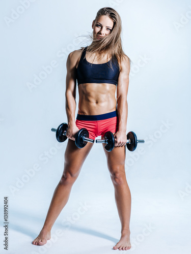 Fototapety, obrazy: Young beautiful fitness female posing in studio