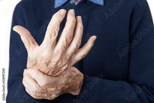 Close Up Of Senior Man Suffering With Arthritis Canvas Print
